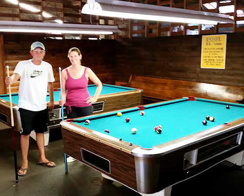 photo of billiard pool tables inside the recreation builiding at North of Highland Camping Area's Cape Cod campgrounds