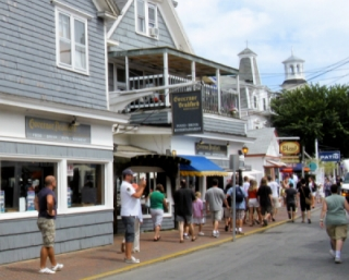 photo of people shopping in Provincetown on Commercial Street with restaraunts, bars and stores