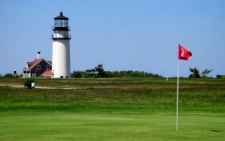 photo of golfing on Cape Cod at Highland Links in North Truro, MA showing Highland Light in the background of one of the holes combining both of these Cape Cod attractions in one photo