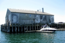 Coastguard pier in Provincetown with artowrk depicting some of the older women of Provincetown
