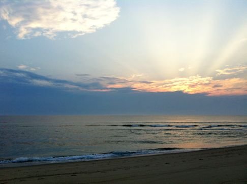 photo showing a sunrise over the ocean at Head of the Meadow Beach, one of Truro's Cape Cod beaches