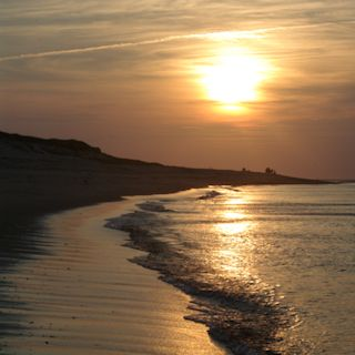 Photo of a sunset over the Cape Cod beaches