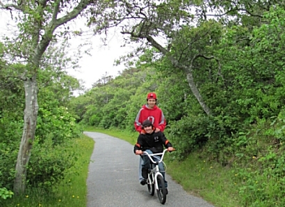 photo of two boys riding a bicycle on Head of the Meadow Cape Cod Bike Trail